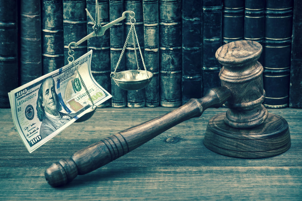 Judge Gavel, Scale Of Justice With Dollar Cash And Law Book On Judges Table