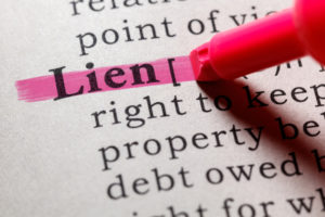 The word LIEN being highlighted by a pink marker in a dictionary