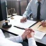 Legal counsel presenting a contract to a client