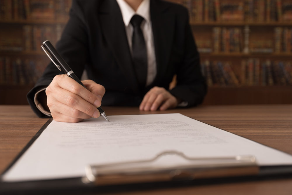 An attorney signing a legal document
