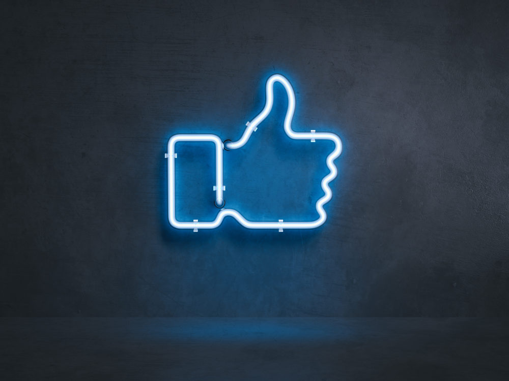 """Neon sign of the Facebook thumbs up """"like"""" icon"""