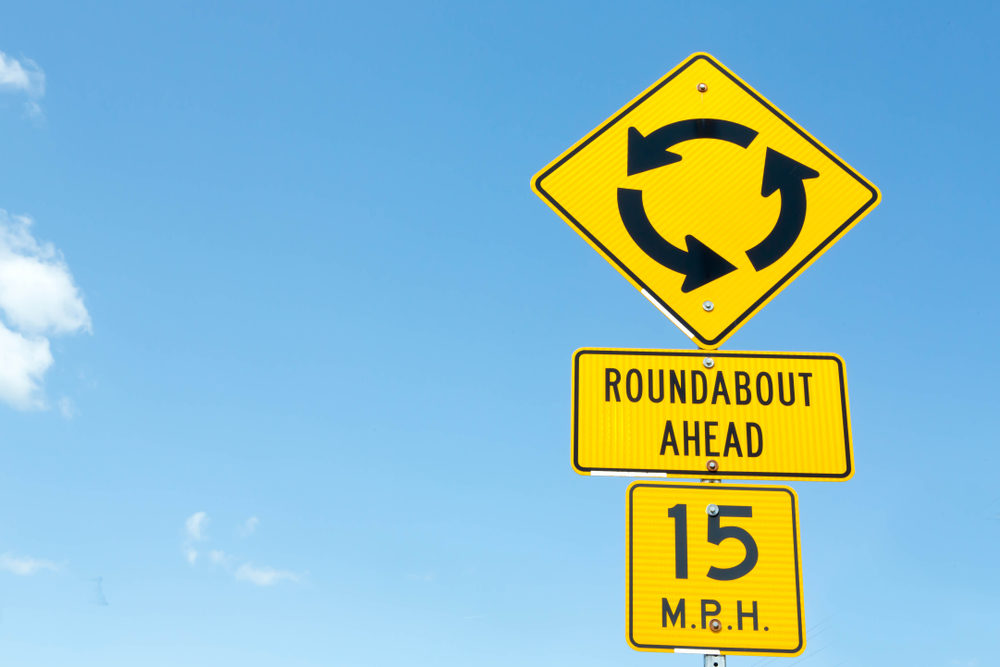 Traffic signs: roundabout ahead, 15mph