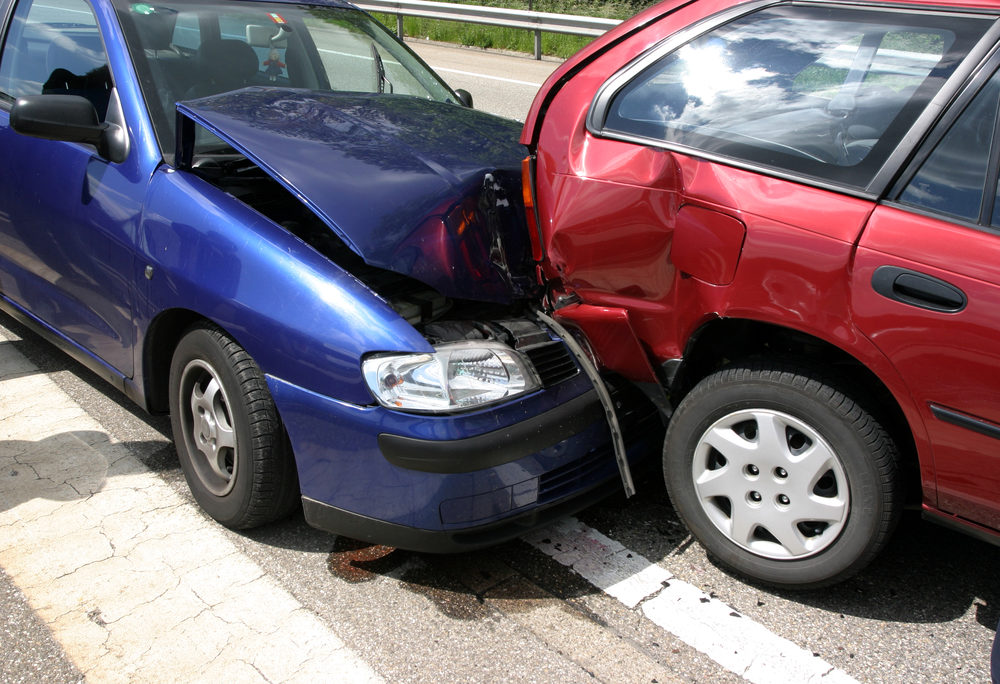 Two vehicles with extensive damage after a read-end collision