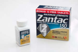 A bottle of Zantac 150 and a box of Zantac 150