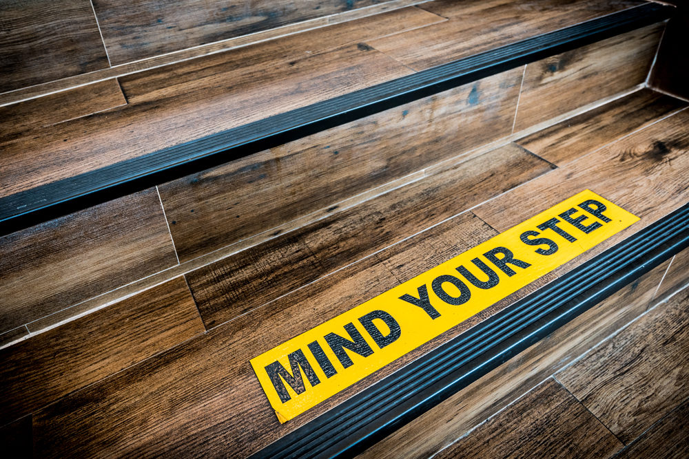 Mind Your Step sign on wooden staircase
