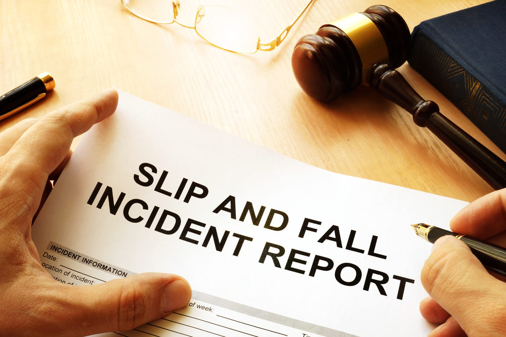 A SLIP AND FALL INCIDENT REPORT being filled out by an attorney