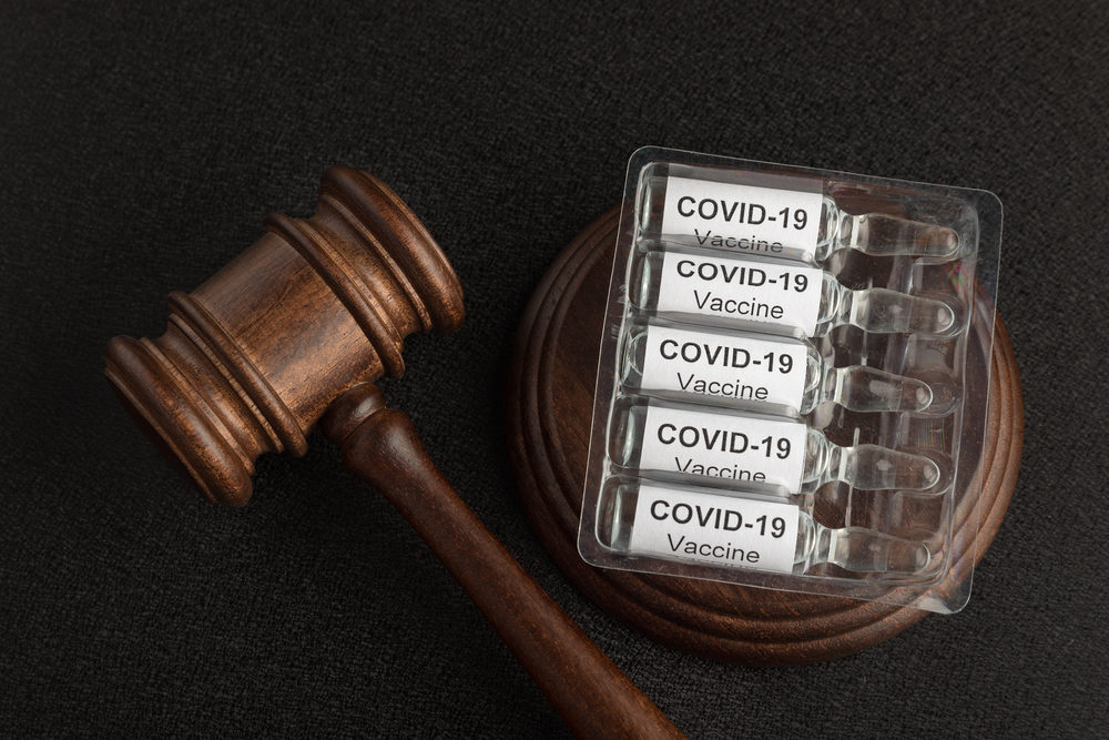 Judge gavel and ampoules with letters covid19.