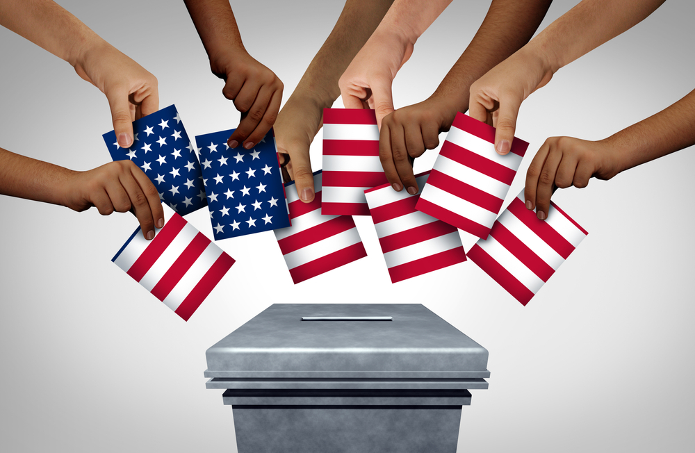 American community vote and US voting diversity concept and diverse hands casting United States ballots at a polling station