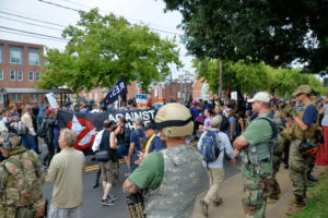 Militia, white supremacists and counter-protesters during a white nationalist rally that turned violent resulting in one death and multiple injuries.