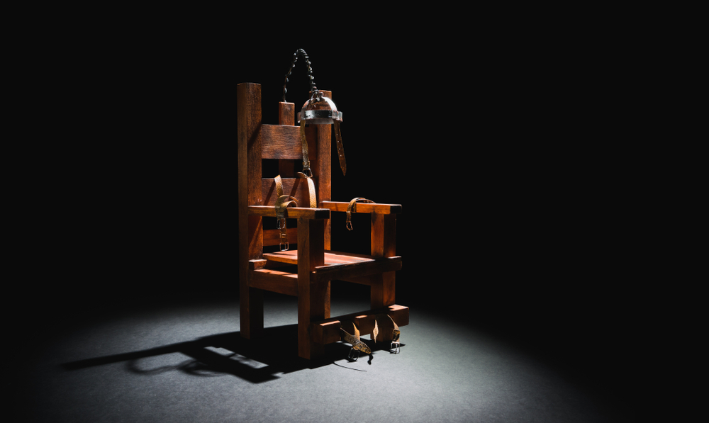 image of an electric chair scale model on a dark backgorund